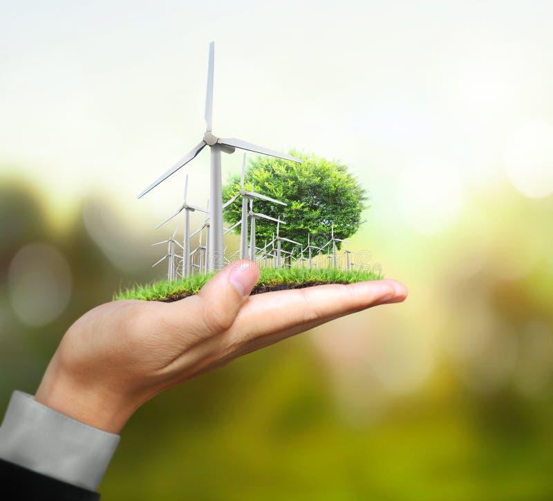 Turbines de vent dans la main illustration libre de droits