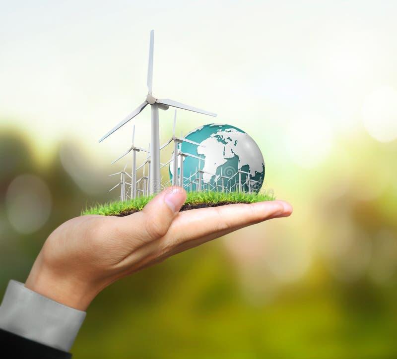 Turbines de vent dans la main illustration de vecteur