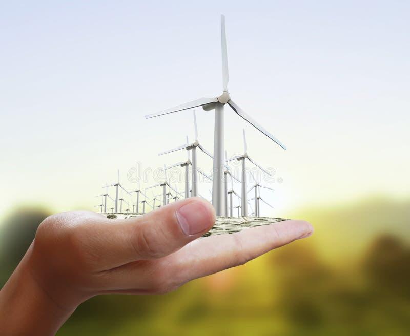 Turbines de vent dans la main illustration stock