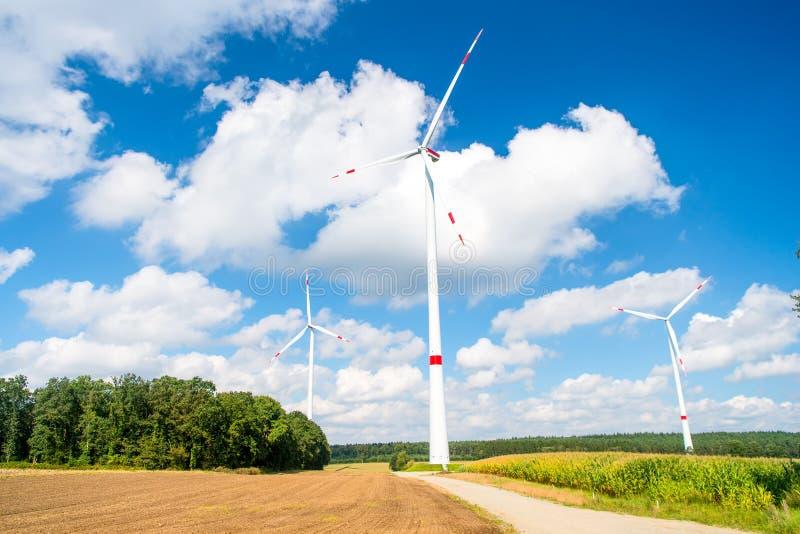 Turbines on field on cloudy blue sky stock photos