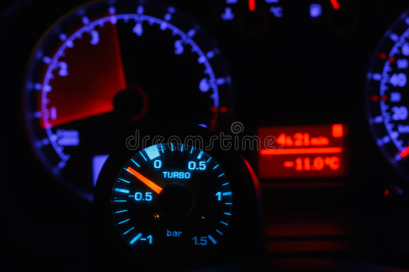 Turbo boost gauge and blurry unfocused speedometer stock photo
