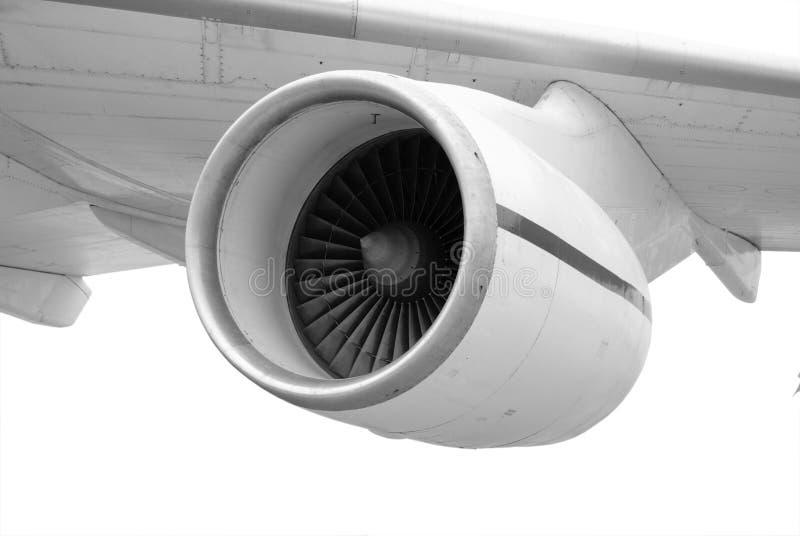 Turboladdare-stråle motor under vingen av ett flygplan arkivbilder