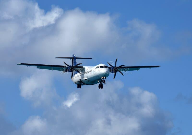 Turboprop airplane in flight stock photos