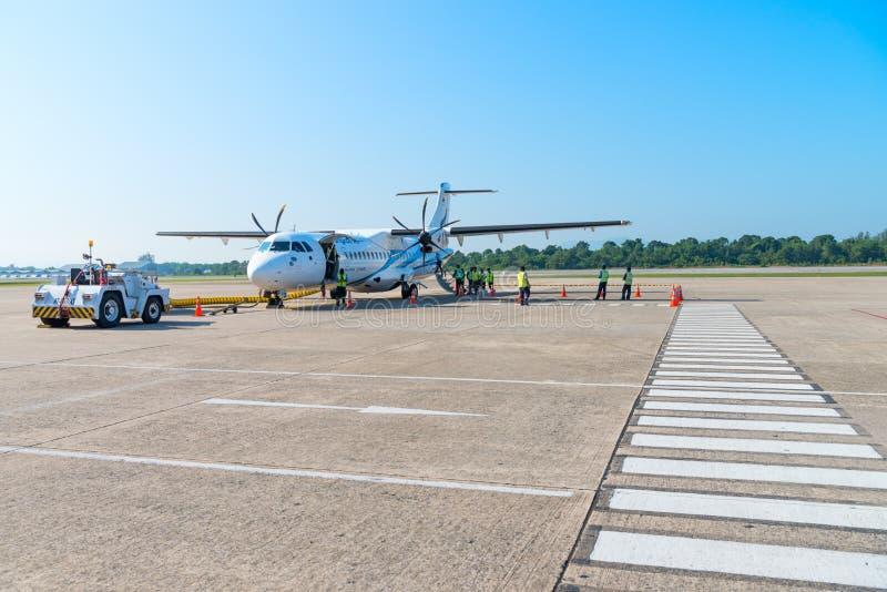Turboprop passenger aircraft of Bangkok Airways in Hat Yai airport. HAT YAI, THAILAND - 24 APR 17: Turboprop passenger airplane of Bangkok Airways in Hat Yai royalty free stock photos