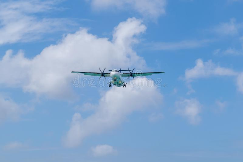 Turboprop powered aircraft with wheels down preparing to land royalty free stock images