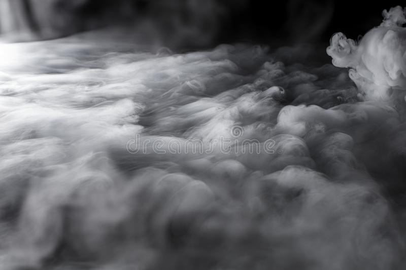 Turbulent Clouds of Dry Ice Fog Billowing royalty free stock photo