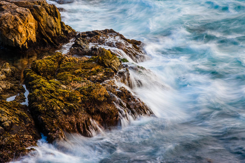 Turbulent Waters. Long Exposure of Turbulent Waters Crashing Into Rocky Coast stock photo