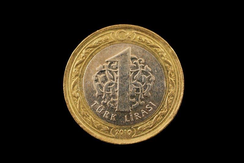 Turc une pièce de monnaie bimétallique de Lire d'isolement sur le noir image libre de droits