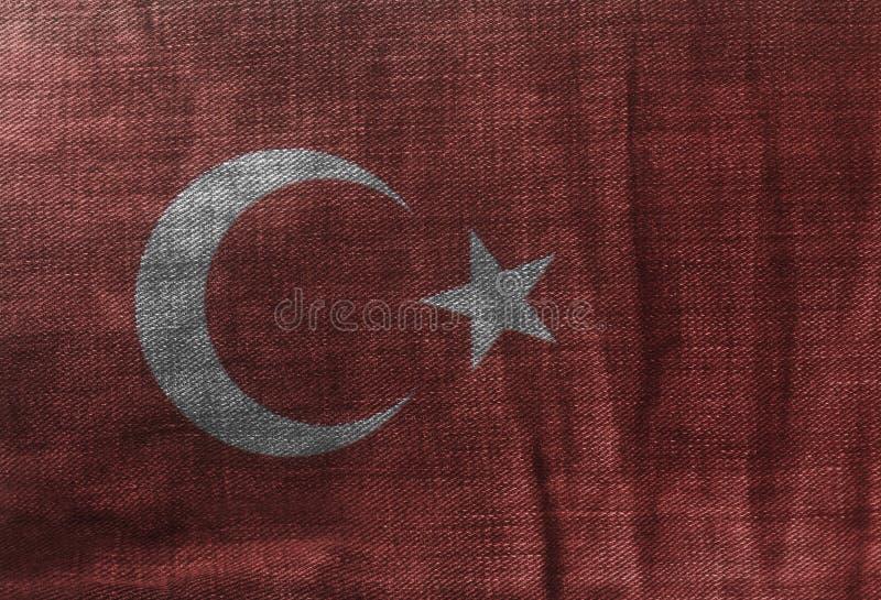 Turecczyzny flaga Na cajgu drelichu teksturze zdjęcie stock