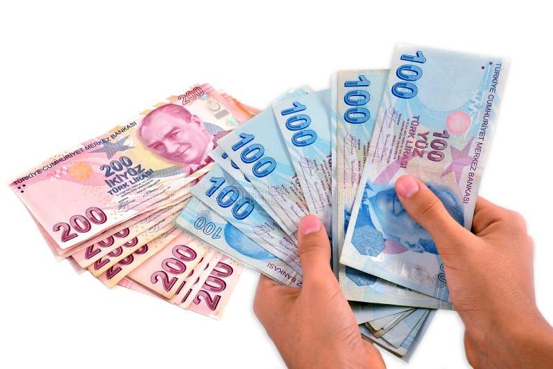 Turecki lir trzymający na biały tle obraz royalty free