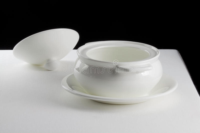 Download Tureen On A Saucer And Cover On A White Tablecloth Stock Photo - Image of ceramics, crockery: 28739494