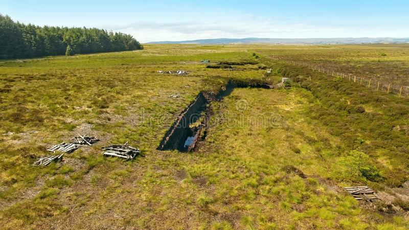 Turf Banks for Cutting Peat with a spade in a Moss Bog in Ireland stock photography