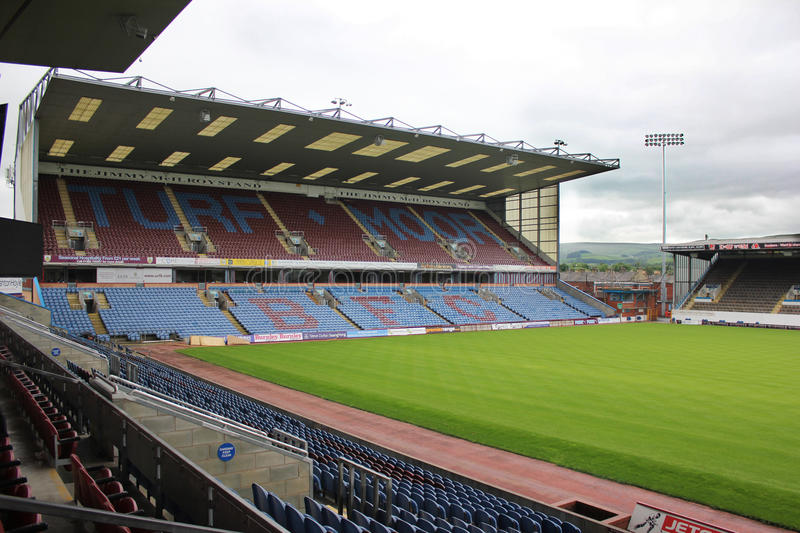 Turf Moor Football Ground, Burnley UK. Turf Moor Football ground, home of Burnley Football Club. Featuring Jimmy McIlroy Stand, Pitch and Bob Lord stand royalty free stock images