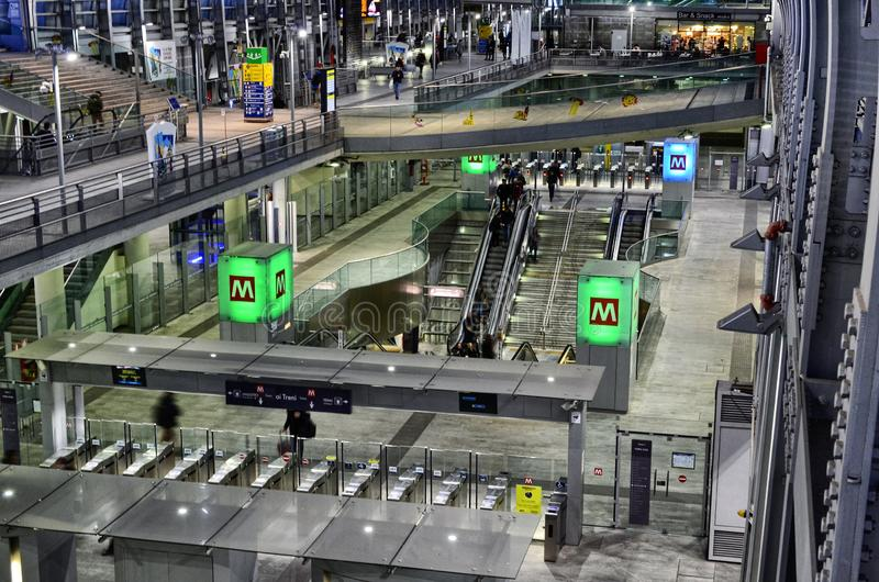 Turin, interior Porta Susa railway station. Turin, Piedmont, Italy. March 2019. Towards sunset the interior of the Porta Susa station, a modern and futuristic royalty free stock images