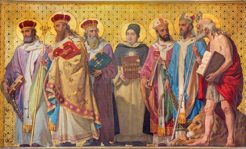TURIN, ITÁLIA - 15 DE MARÇO DE 2017: O fresco simbólico de doutores santamente da igreja com na igreja Chiesa di San Dalmazzo foto de stock