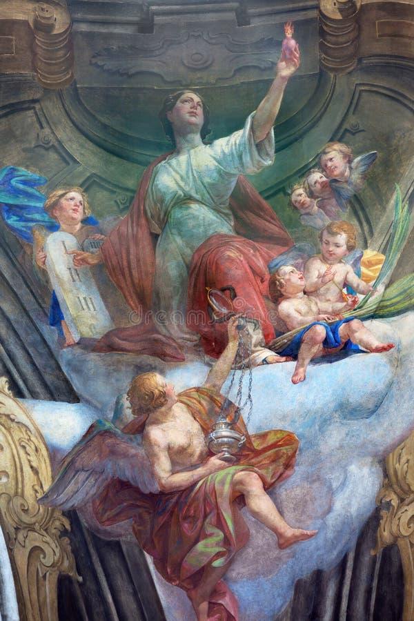 TURIN ITALIEN - MARS 13, 2017: Freskomålningen av huvudsakliga förtjänster av förälskelse i kupol av den Chiesa dellaen Visitazio royaltyfri fotografi