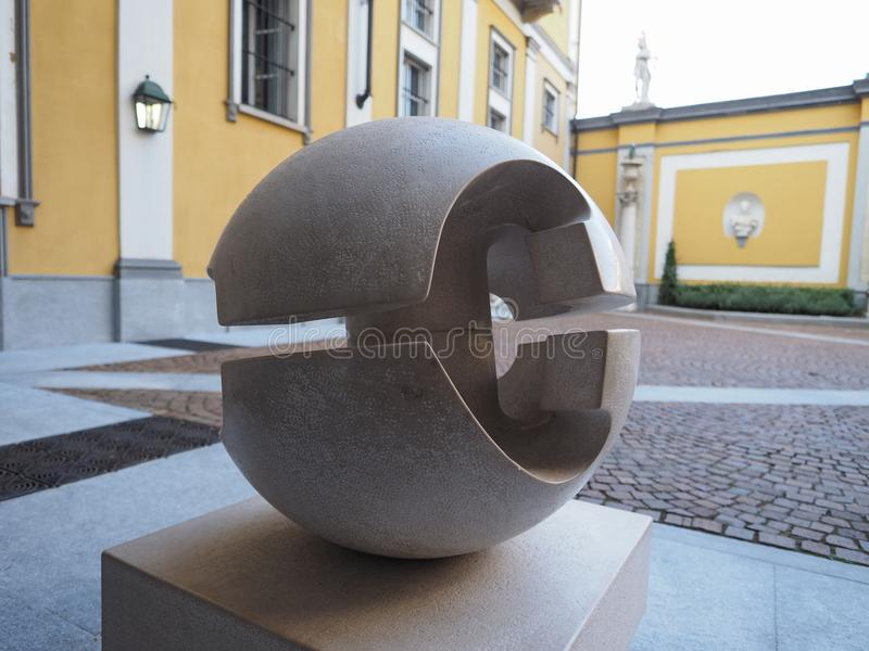 Gio Pomodoro sculpture in Turin. TURIN, ITALY - CIRCA AUGUST 2017: Stone sculpture entitled Guscio (meaning Shell) by artist Gio Pomodoro outside Accorsi Ometto royalty free stock photos