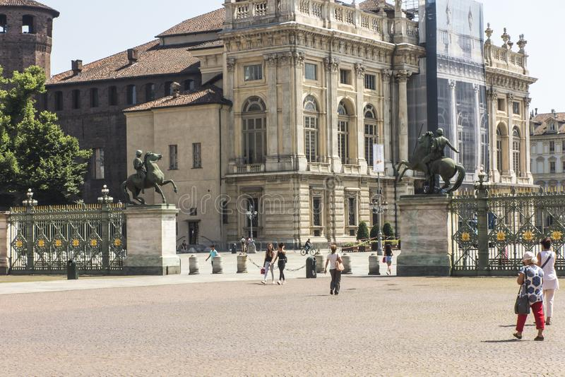 Turin, Italy, 27 June 2019: Two statues of riders on horseback and in the background Palazzo Madama on the Castle Square in Turin royalty free stock photography