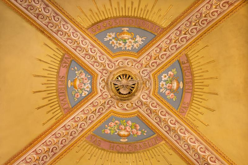 TURIN, ITALY - MARCH 15, 2017: The detail of fresco on the ceiling in church Basilica Maria Ausiliatrice royalty free stock photo