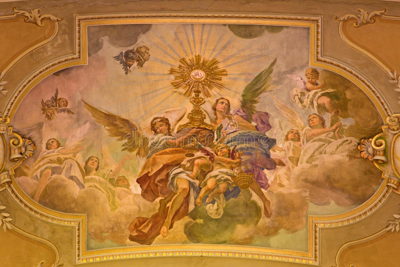 TURIN, ITALY - MARCH 13, 2017: The fresco of Eucharistic adoration of angels in ceiling of church Chiesa di Santo Tomaso royalty free stock images