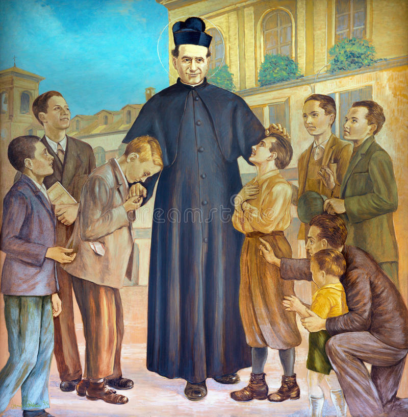 TURIN, ITALY - MARCH 15, 2017: The painting of Saint Don Bosco in the middle of his boys in church Basilica Maria Ausiliatrice stock photography