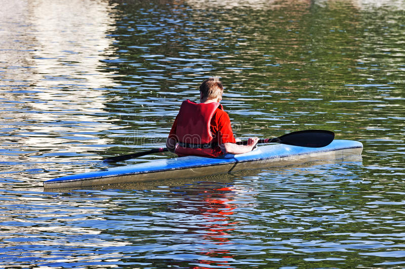 Turin, Italy May 9, 2014 athlete enjoy outdoors sports, he is rowing in the Po river stock images