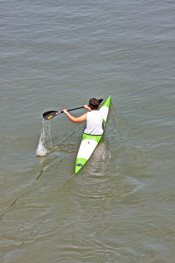 Turin, Italy May 9, 2014 athlete enjoy outdoors sports,he is rowing in the Po stock photos