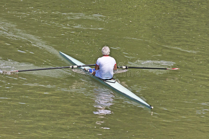 Turin, Italy May 9, 2014 athlete enjoy outdoors sports, he is rowing in the Po stock photos