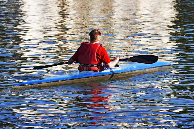 Turin, Italy May 9, 2014 athlete enjoy outdoors sports, he is rowing in the Po royalty free stock images