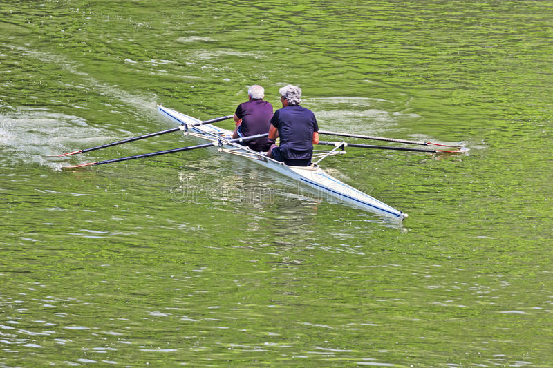 Turin, Italy May 9, 2014 athletes enjoy outdoors sports, they are rowing in the Po royalty free stock images