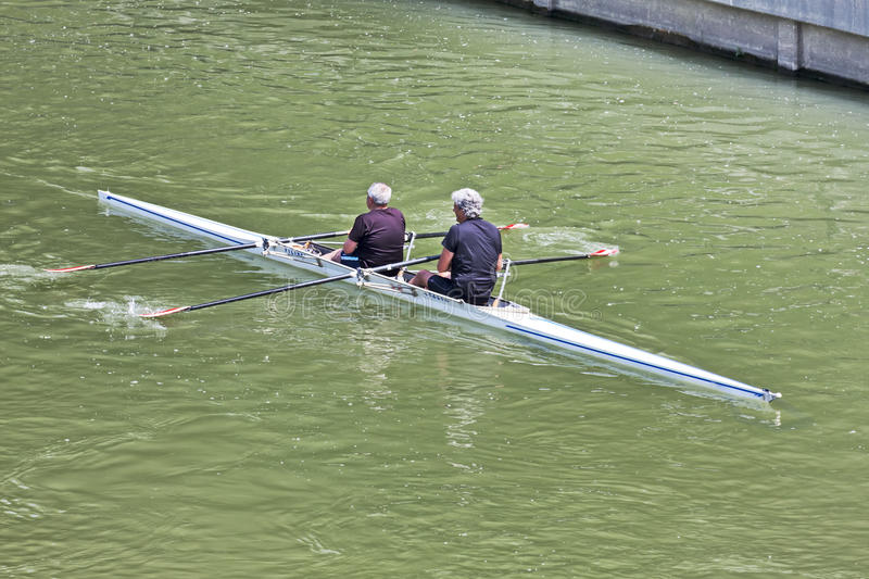 Turin, Italy May 9, 2014 athletes enjoy outdoors sports,they are rowing in the Po stock images