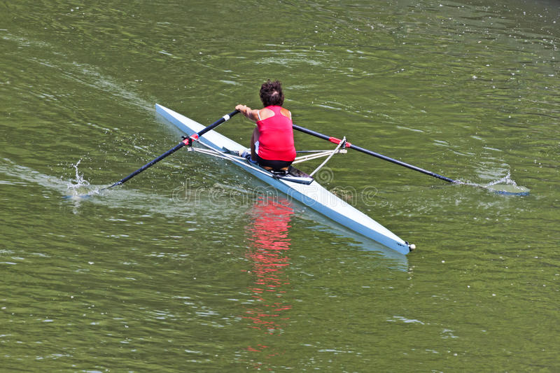 Turin, Italy May 9, 2014 athletic woman enjoy outdoors sports, she is rowing in the Po royalty free stock images
