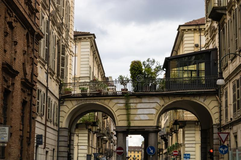 TURIN, ITALY - 25 May 2019: Passage with plants and Turin street view, Torino, Italy - Image. TURIN, ITALY - 25 May 2019: Passage with plants and Turin street royalty free stock photos