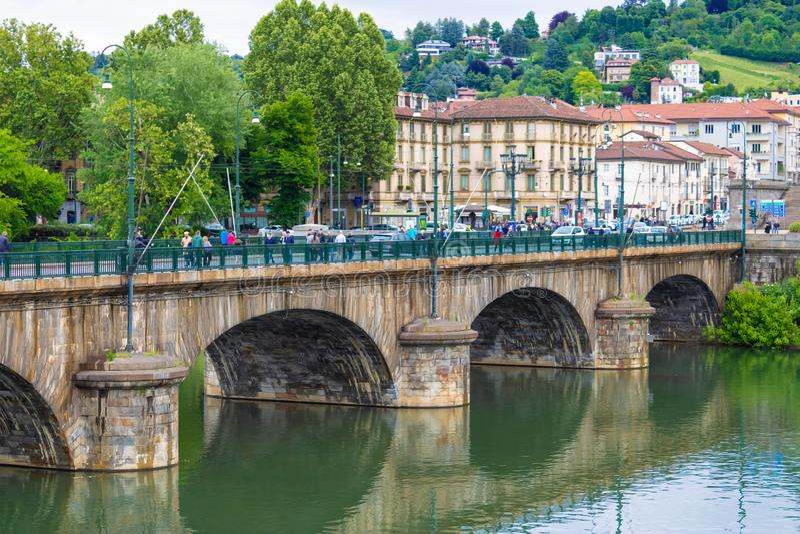 TURIN, ITALY - 25 May 2019: View at Po river and Bridge Umberto I in Turin, Italy - Image. TURIN, ITALY - 25 May 2019: View at Po river and Bridge Umberto I in royalty free stock photo