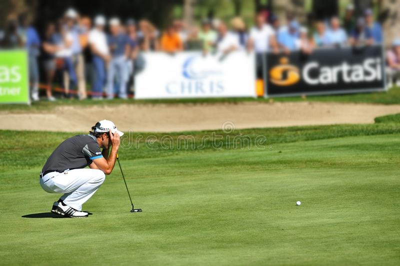 Turin Italy Unknown golf player concentrate seek the line squatted on green stock photography