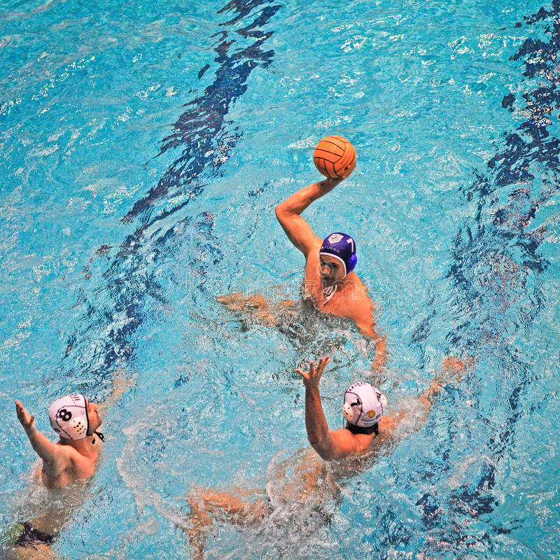 Water polo match Torino81 Vs Como Nuoto. TURIN - MARCH 23: Unidentified player of Como Nuoto team during an attack's action in the water polo match between stock photo