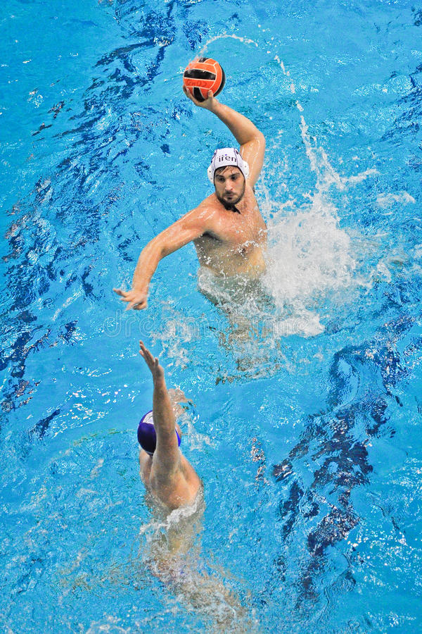 Water polo match Torino81 Vs Como Nuoto. TURIN - MARCH 23: Unidentified player of the Torino81 team plays an attack's action during the water polo match between stock image