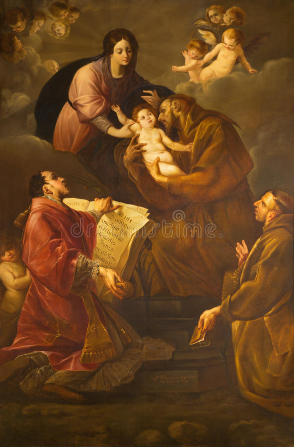 Turin - The painting of Madonna with the St. Francis of Asissi and St. Lorenzo in church Chiesa di Santa Maria in Monte. TURIN, ITALY - MARCH 13, 2017: The stock photos