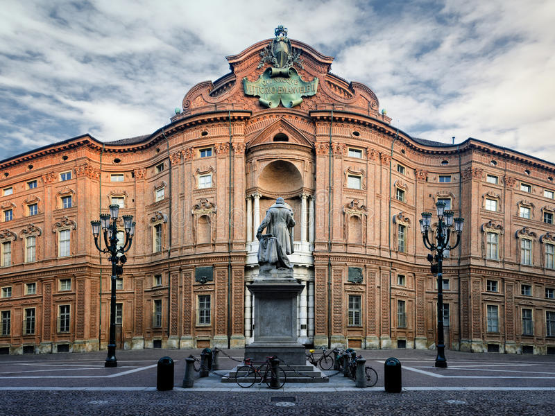 Turin, Palazzo Carignano. Piazza Carignano, one of the main squares of Turin Italy with Palazzo Carignano, historic baroque palace and first italian parliament royalty free stock image