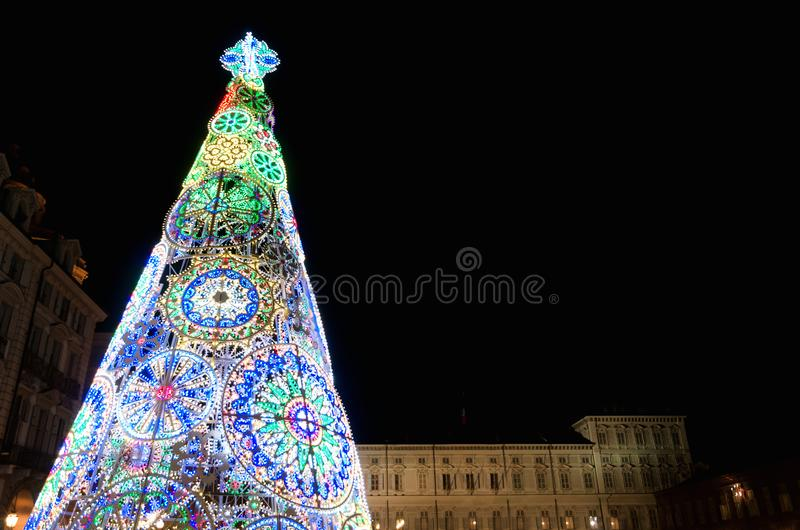 Turin, Piazza Castello with christmas tree. Trin Piedmont, Italy: Piazza Castello, main square of the city, illuminated by the christmas tree at night, with royalty free stock photography