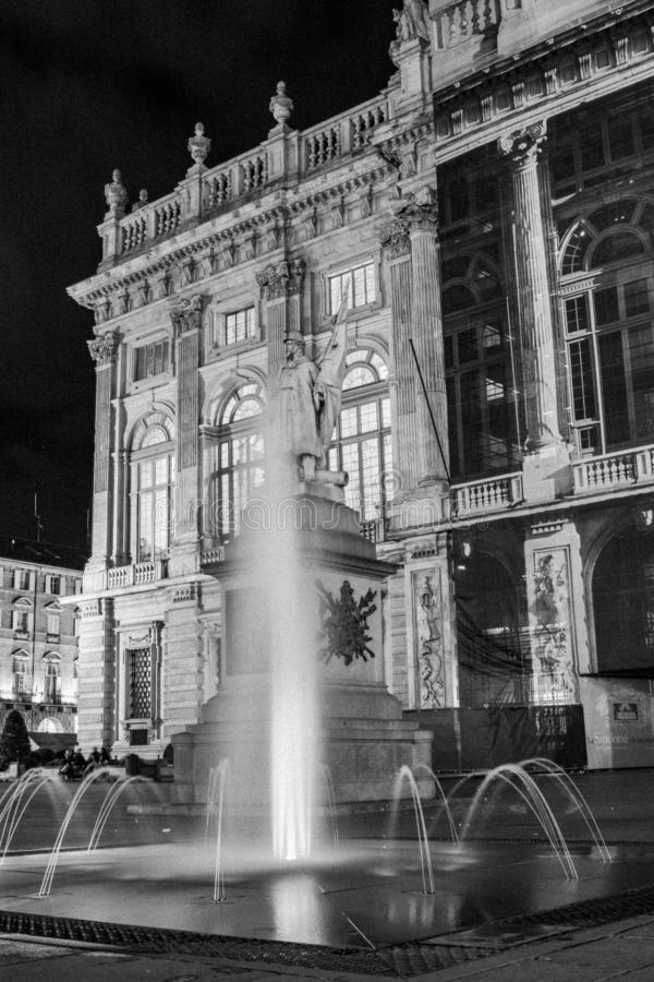 Turin, Piedmont, Italy. Night view of piazza castello in black and white with madama palace behind the fountain stock images