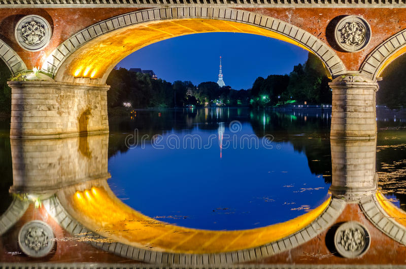 Turin Torino Ponte Isabella and river Po at blue hour. With Mole Antonelliana in the background royalty free stock photo