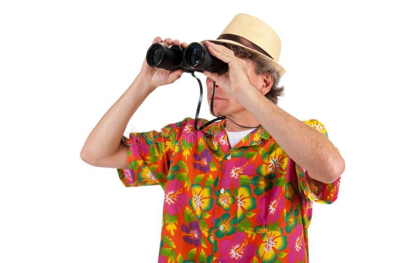 Turist med binokulärt royaltyfria bilder