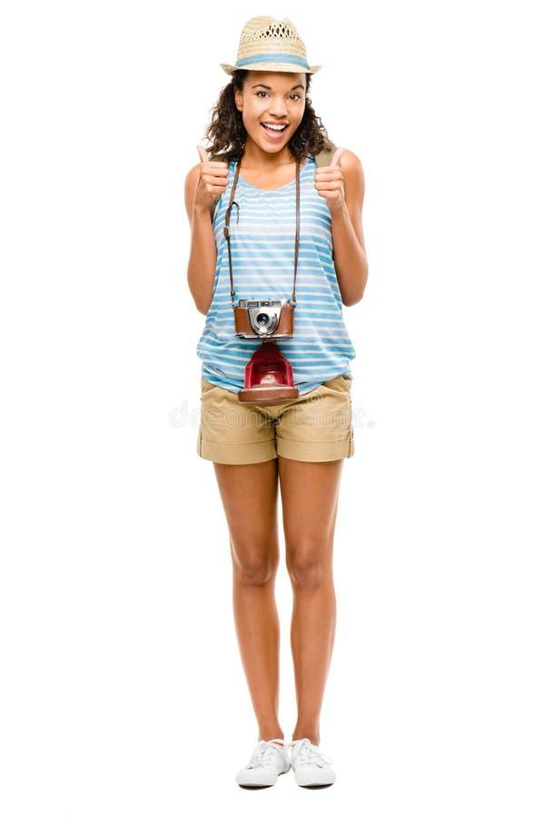 Turist- tummar för lycklig afrikansk amerikankvinna som isoleras upp på vit royaltyfri foto