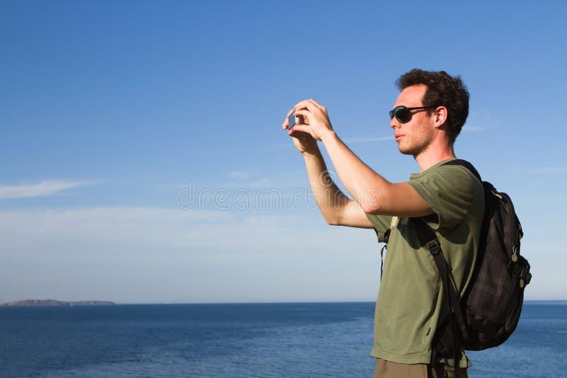 Turista com móbil foto de stock