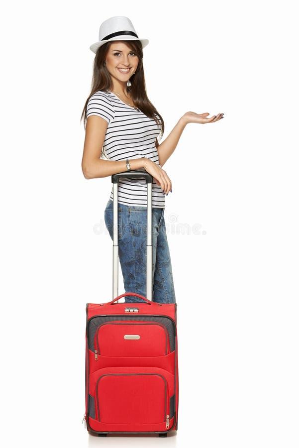 Turista da mulher com mala de viagem fotografia de stock