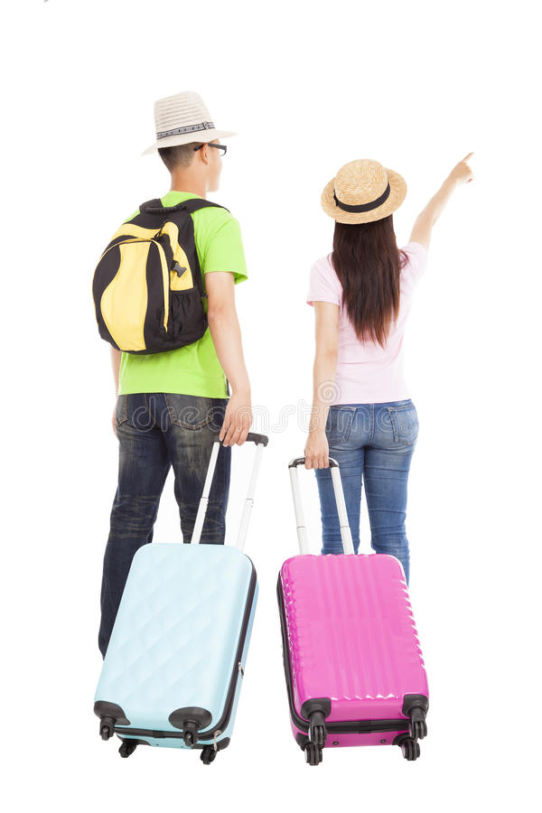 Turista feliz de los pares con la maleta del viaje imagen de archivo libre de regalías