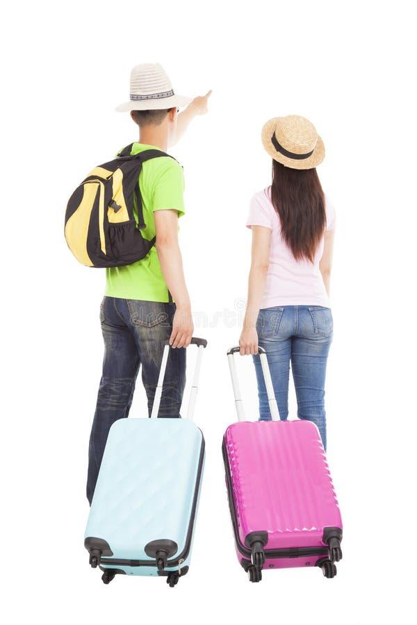 Turista joven de los pares con la maleta del viaje fotos de archivo libres de regalías