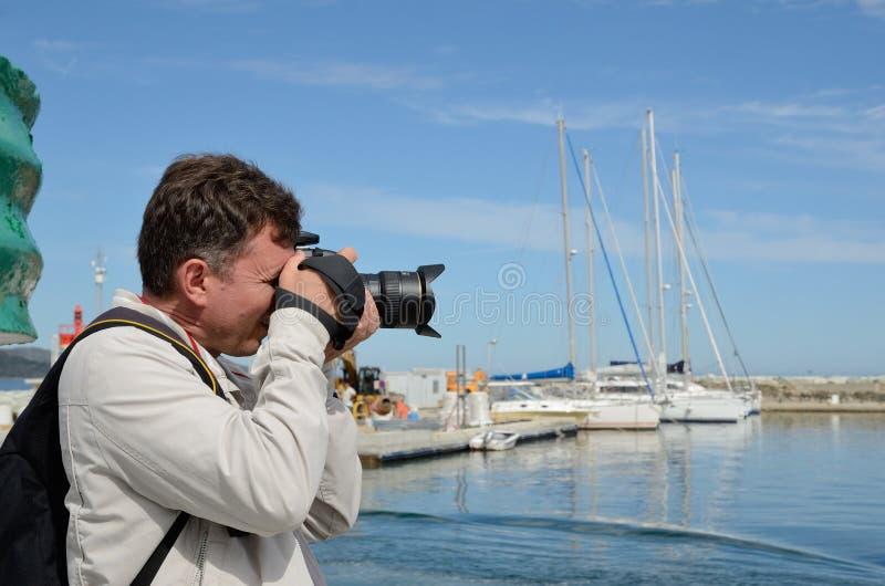 Turista nel san-Florent corso del porto fotografia stock libera da diritti