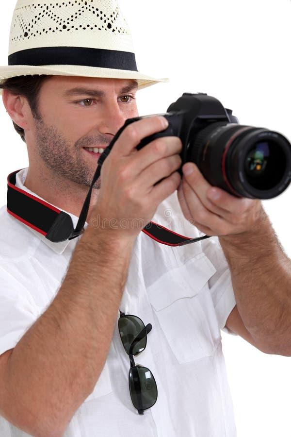 Turista que toma las fotos con la cámara fotos de archivo libres de regalías
